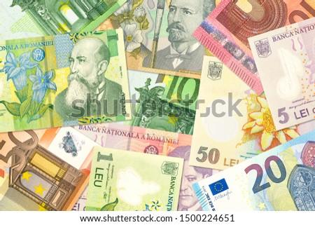 some romanian leu banknotes and euro banknotes mixed indicating bilateral economic relations #1500224651