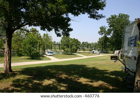 Some RV's parked at the lake for the weekend