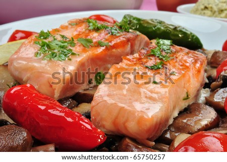 some salmon steak with mushroom and tomato