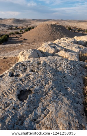 Some scripts of the temple of the Seven Planets and great central mound at Sogmatar in Sanliurfa, Turkey. #1241238835