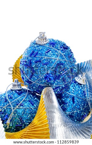 some shiny blue christmas ball and a silver and golden garland on a white background - stock photo