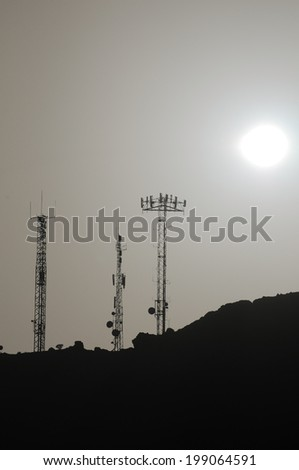 Some Silhouetted Antennas on the top of a Hill