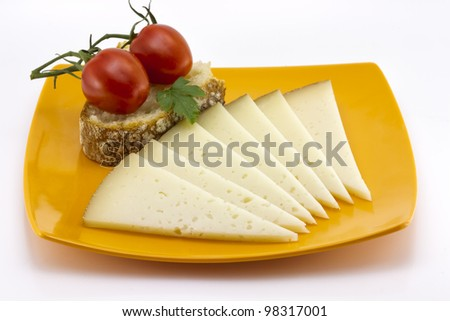 some slices of manchego cheese from Spain, Bread and tomato