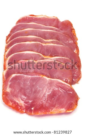 some slices of marinated tenderloin on a white background