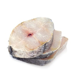 some slices of raw hake on a white background