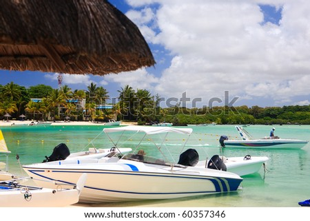 Some small boats at tropical beach resort