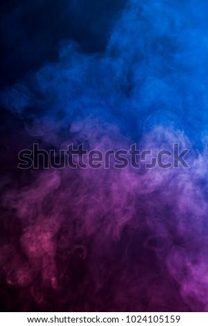 Some smoke in the dark.  - Shutterstock ID 1024105159