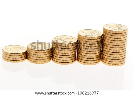 some stacks of coins on white background �¢â���¬