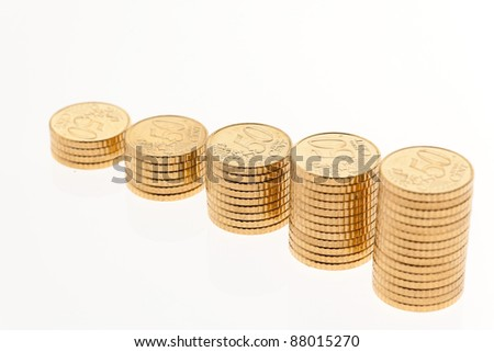 some stacks of coins on white background ?