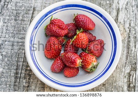 Some strawberries in old wood background