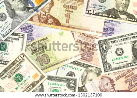 some transnistrian ruble banknotes and american dollar banknotes mixed indicating bilateral economic relations #1502137100