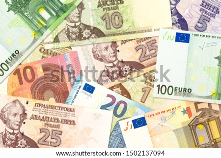 some transnistrian ruble banknotes and euro banknotes mixed indicating bilateral economic relations #1502137094