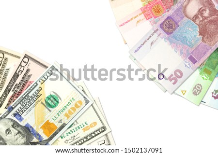 some ukrainian hryvnia banknotes and american dollar banknotes indicating bilateral economic relations with copyspace #1502137091