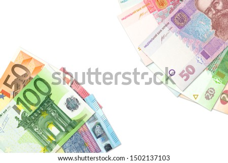some ukrainian hryvnia banknotes and euro banknotes indicating bilateral economic relations with copyspace #1502137103