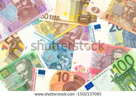 some ukrainian hryvnia banknotes and euro banknotes mixed indicating bilateral economic relations #1502137085
