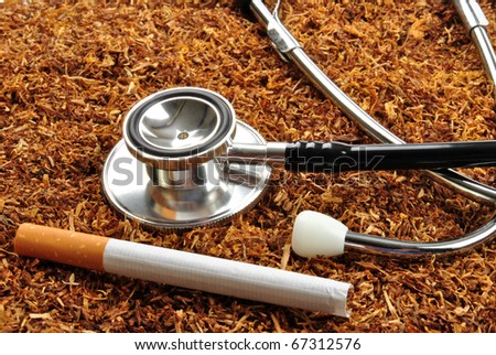 some unhealthy tobacco cigarette and a stethoscope