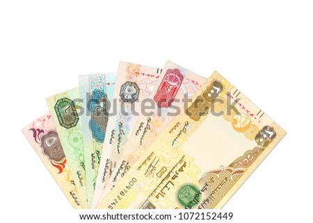 some united arab emirates dirham bank notes isolated on white background #1072152449