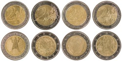 Some used European 2 Euro Coins (front and back) isolated on white background