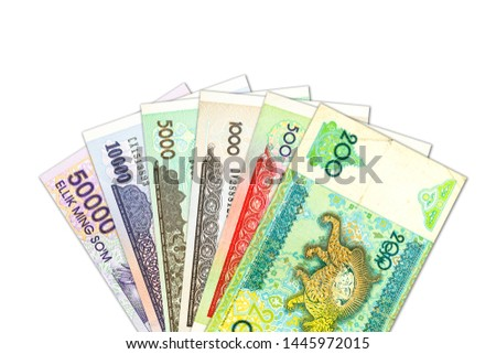 some Uzbek Som banknotes indicating growing economy with copyspace #1445972015
