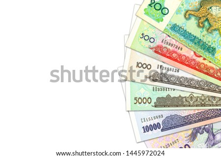 some Uzbek Som banknotes indicating growing economy with copyspace #1445972024