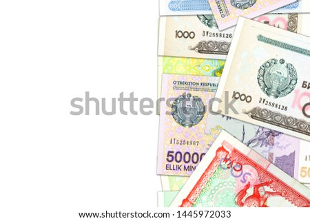 some Uzbek Som banknotes indicating growing economy with copyspace #1445972033