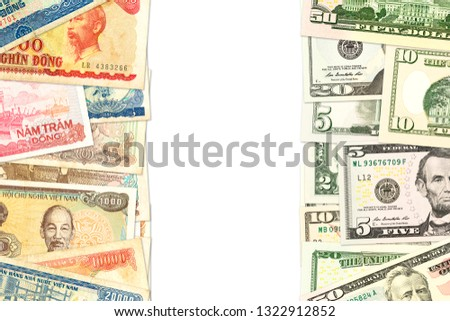 some vietnamese dong bank notes and us-dollar bank notes with copyspace indicating trade relations #1322912852