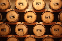 Some whiskey made from rye aging in barrels