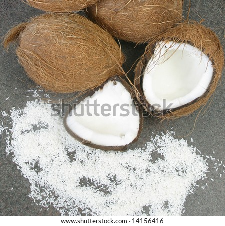 Some whole and broken coconuts.