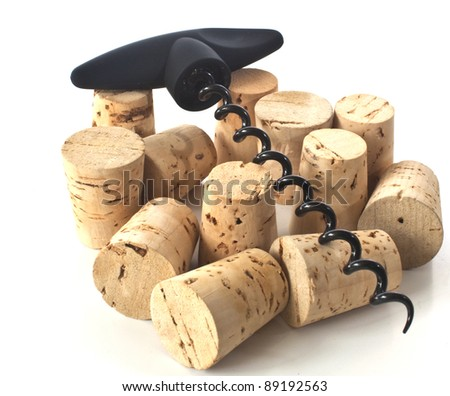 some wine corks with a corkscrew