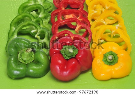 some yellow, red and green peppers sliced