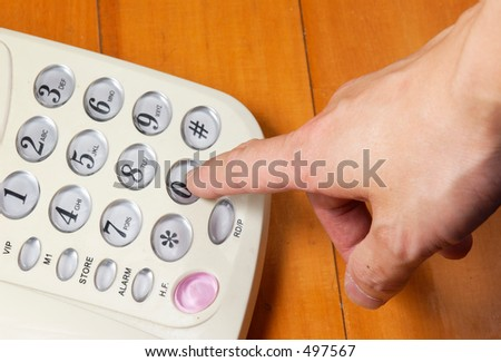 someone dialling a telephone