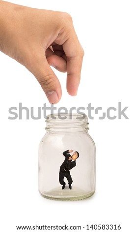 Someone hand are pick man in suit inside glass bottle