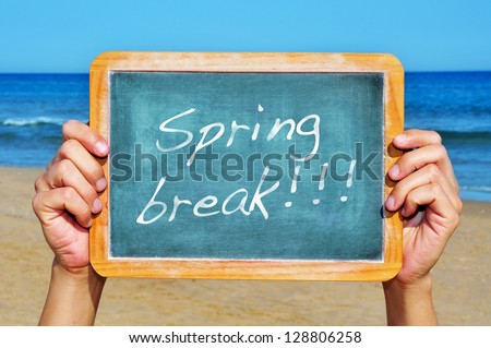someone holding a blank blackboard at the beach with the sentence spring break written in it