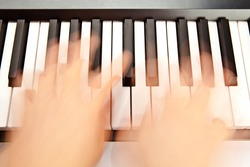 Someone playing piano in motion
