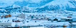 Sommaroy, Tromso county, Norway : scattered houses by the sea during arctic winter