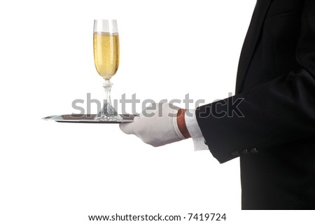 Sommelier in Tuxedo Serving Champagne Glass on a silver tray isolated over white. Man is unrecognizable.