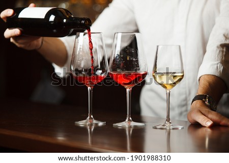 Sommelier pouring different types of fine wine Stock photo ©