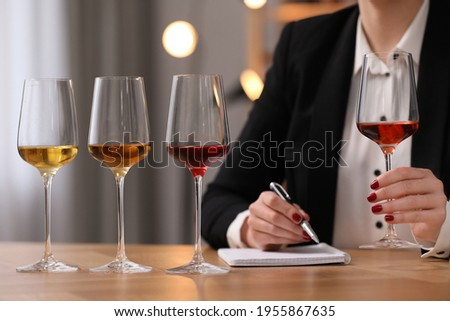 Sommelier tasting different sorts of wine at table indoors, closeup Stock photo ©