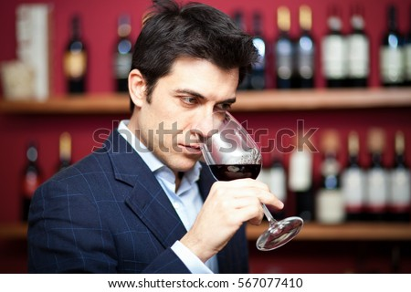Sommelier tasting red wine #567077410