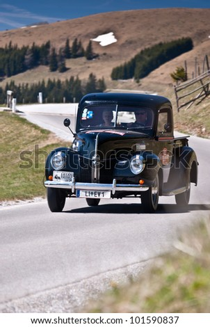 "SOMMERALM, AUSTRIA - APRIL 27: Erich Volk in a 1940 Ford USA Pick Up participates in a rally for vintage cars ""Suedsteiermar k Classic"" on April 27, 2012 in Sommeralm, Austria. - stock photo"