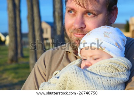 son and father  outside in evening sun- shot in natural light