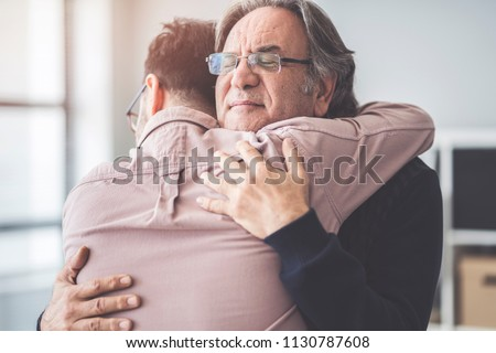 Son hugs his own father Stock foto ©