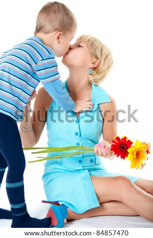 Son kisses his mother favorite, white background - stock photo