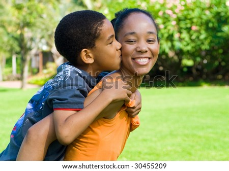 son kissing mother - stock photo