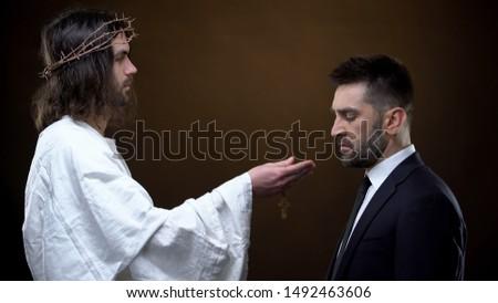 Son of God giving wooden cross businessman, salvation of soul, sins forgiveness