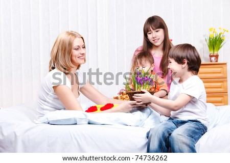 Son presenting flowers to mother