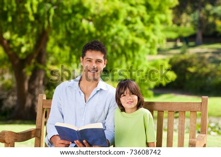 Son with his father reading a book