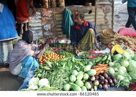 SONAKHALI, INDIA - JANUARY 17: Tribal villagers bargain for vegetables on January 17, 2009. Sonakhali, West Bengal, India. 42% of India falls below the international poverty line of $1.25 a day.