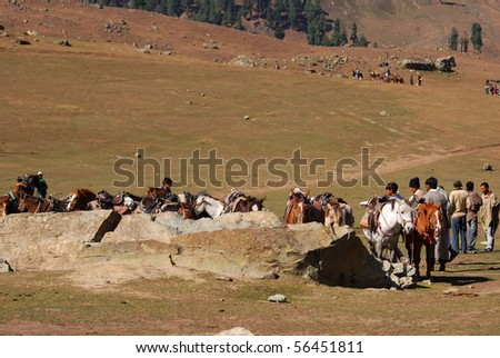 SONAMARG, INDIA - OCTOBER 14: Local people offer horse ride for tourists, October 14, 2009 in Sonamarg, Kashmir, India