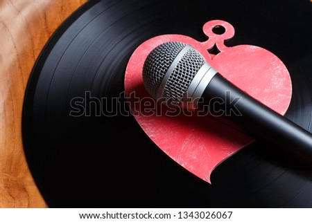 Song for lovers. Nostalgic songs, concept with vinyl records, microphone and heart #1343026067